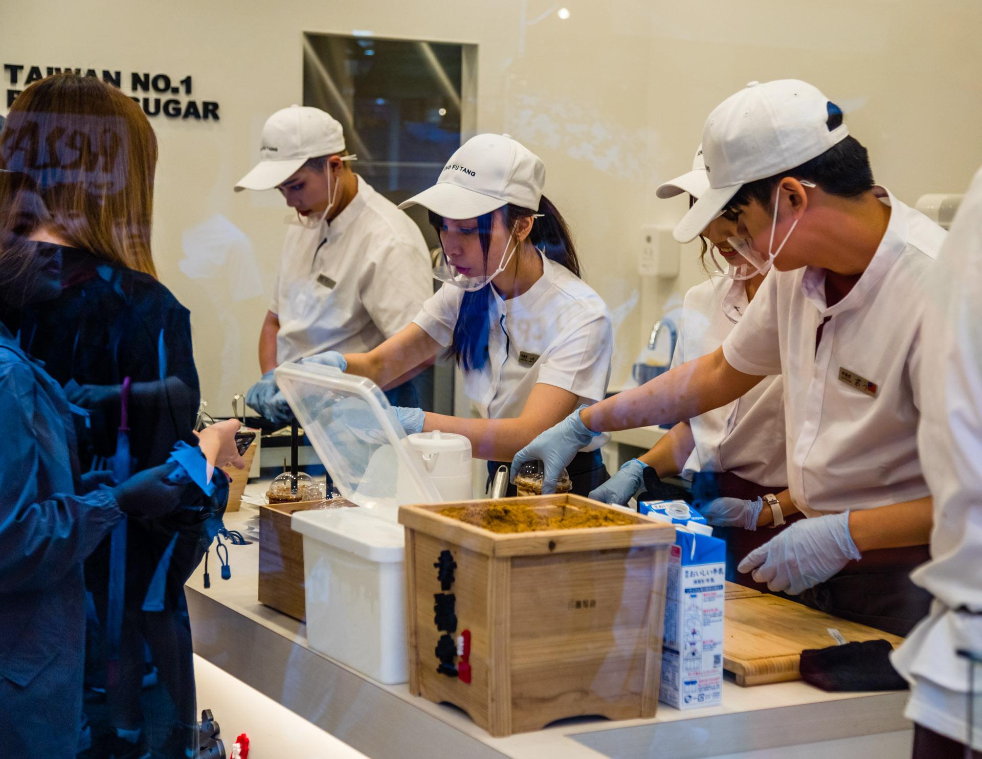 Manufactuers and sellers of Taiwanese Sweets wearing protective masks, Shibuya, Tokyo, Japan